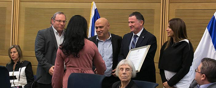 Kiram Baloum, CEO of Jasmine, is getting the award from the chairman of the Knesset